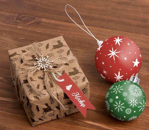 High angle christmas present and globes Free Psd