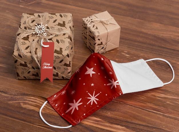 High angle christmas presents and mask Free Psd
