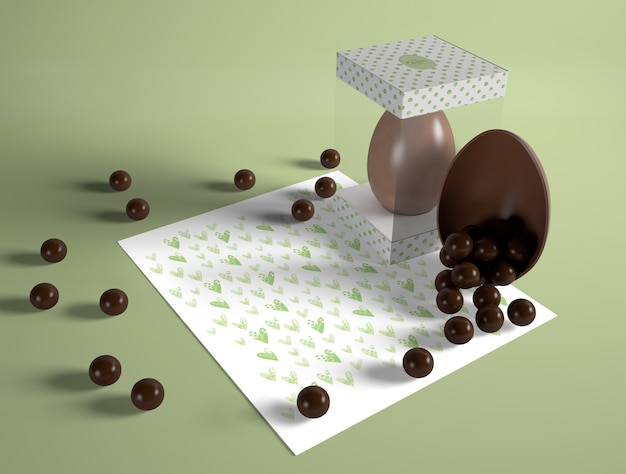 High angle easter egg with chocolate candies Free Psd