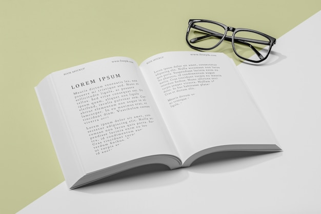 High angle glasses and open book mock-up Free Psd