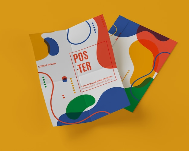 High angle of multicolored shapes on papers Free Psd