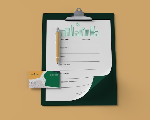 High angle of notepad with paper and card Free Psd