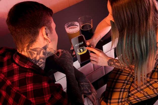 High angle people with beer and phone mock-up Free Psd