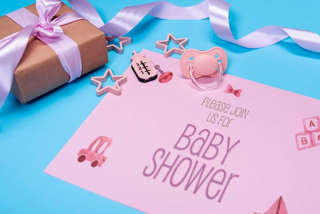 High angle of pink baby invitation with gift Free Psd
