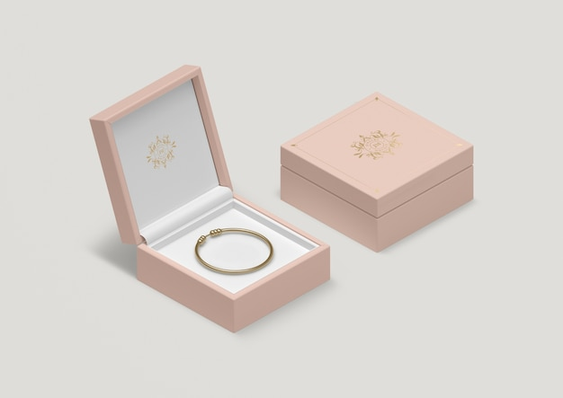 High angle pink jewelry box with golden bracelet Free Psd