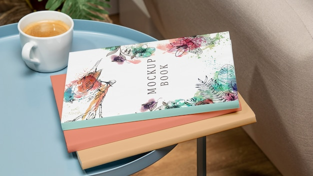 High angle stack of books mock-up on coffee table Free Psd
