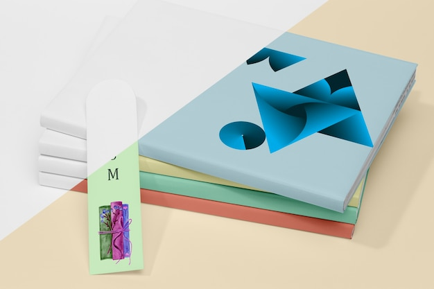 High angle stack of books mock-up with bookmark Free Psd