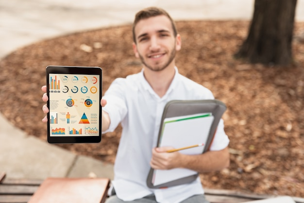 High angle university male holding tablet Free Psd