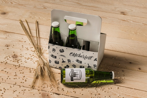 High view beer bottles with wooden background Free Psd