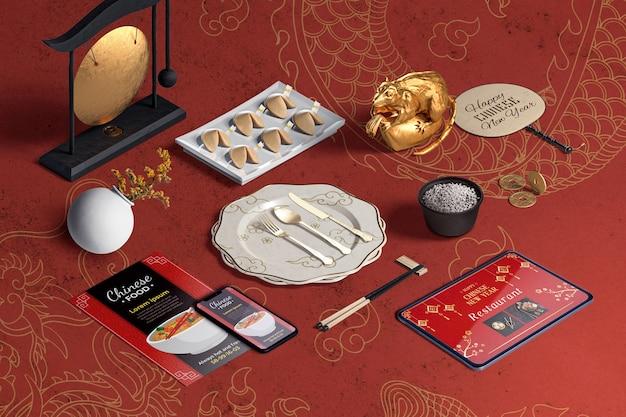 High view столовые приборы и печенье с предсказаниями на китайский новый год Бесплатные Psd