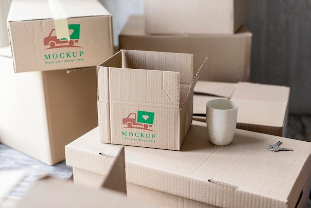 High view moving house boxes and cup of coffee Free Psd