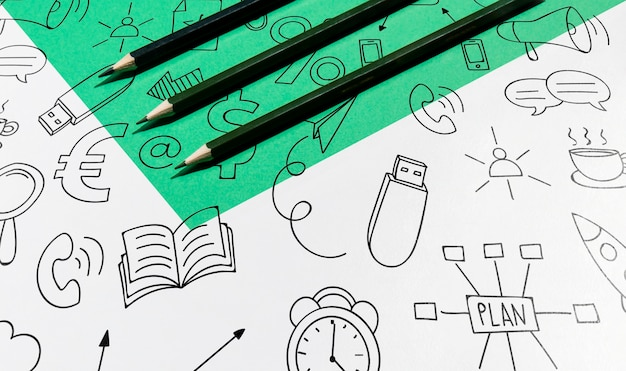 High view pencils and doodles knolling desk concept Free Psd