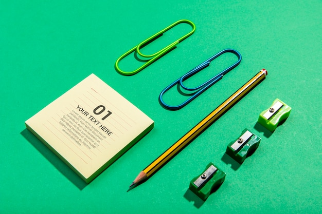 High view sticky-notes and pencil knolling desk concept Free Psd