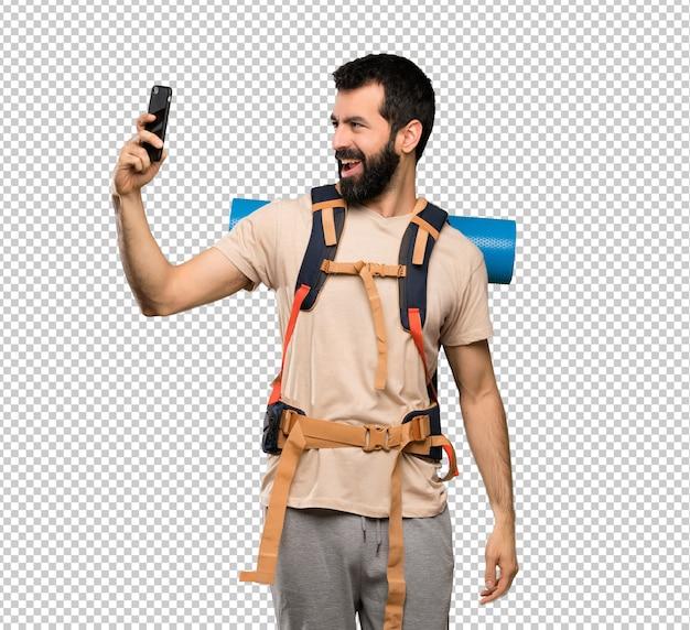 Hiker man making a selfie Premium Psd