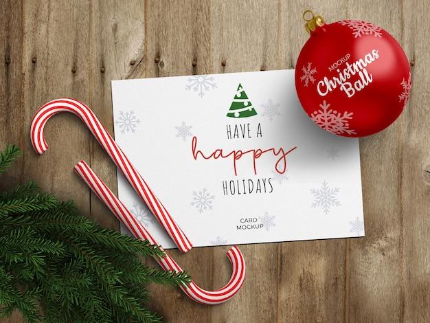 휴일 인사말 카드와 크리스마스 공 모형 프리미엄 PSD 파일