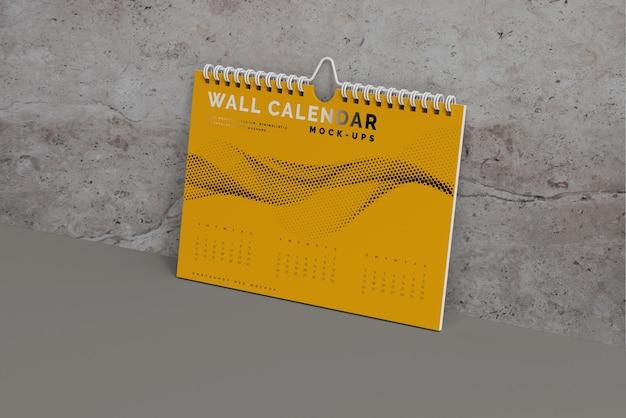 Мокап горизонтального настенного календаря Бесплатные Psd