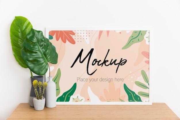 Composizione interna con cornice e pianta mock-up Psd Gratuite