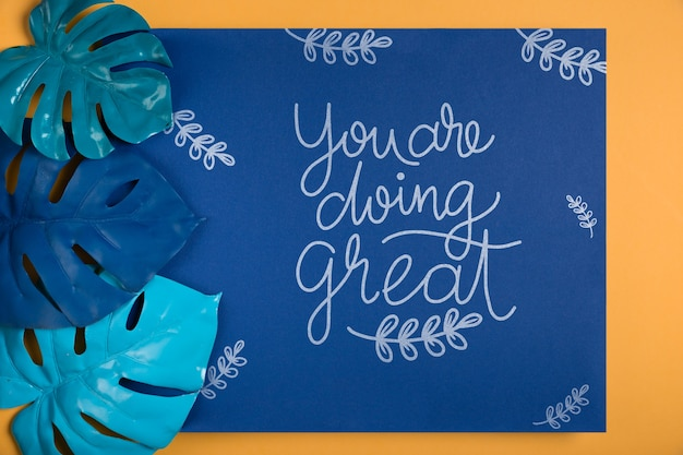 Inspirational message with leaves beside Free Psd