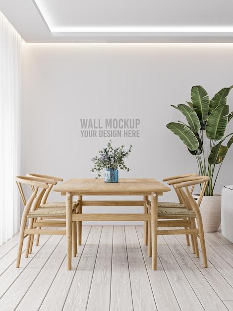 木製のテーブルと植物と白い壁のインテリアダイニングルームの壁のモックアップ Premium Psd