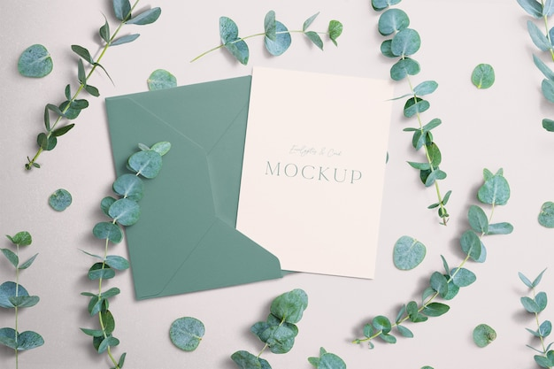 Invite mockup with eucalyptus and envelope Premium Psd