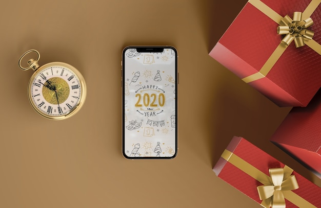 Iphone mock-up with gifts Free Psd