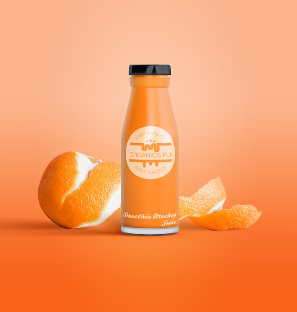 Isolated bottle of fruit juice and oranges Free Psd