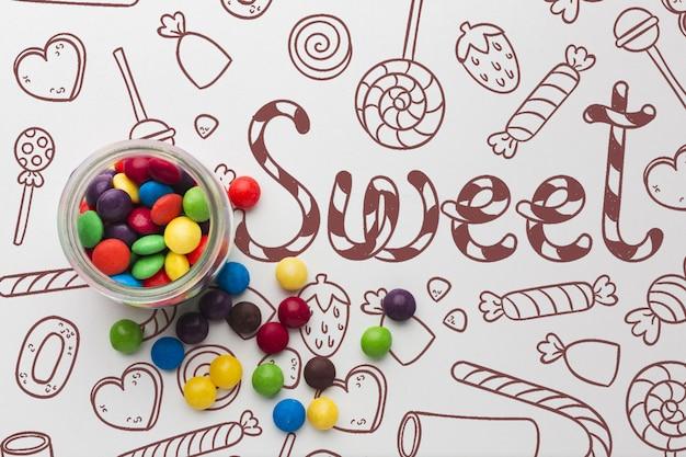 Баночка с конфетами на столе Бесплатные Psd