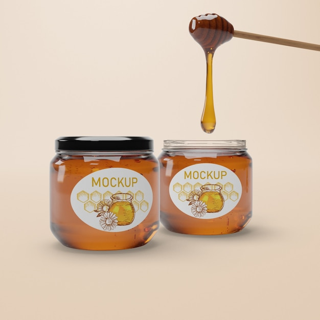 Jar with natural honey mock-up on table Free Psd