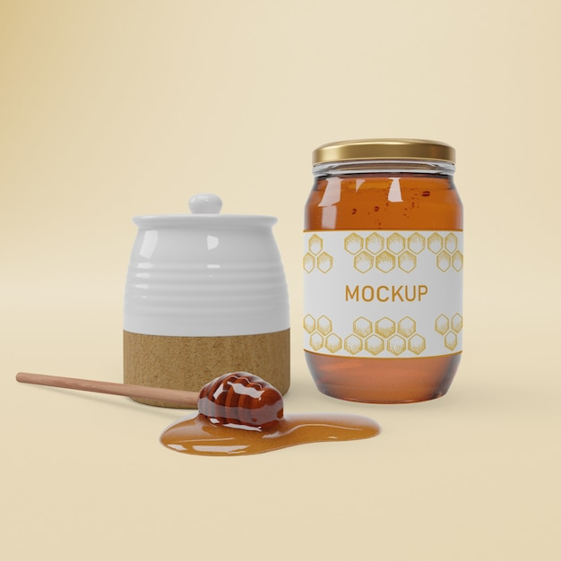 Jar with organic honey on table Free Psd