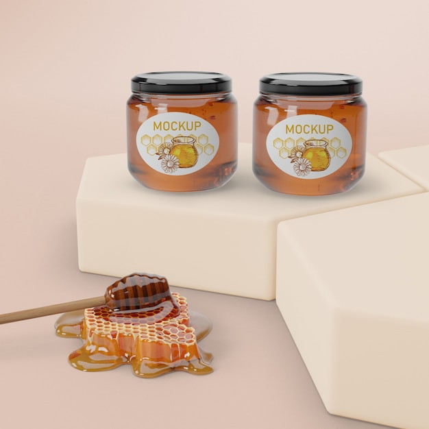 Jars with honey aligned on table Free Psd