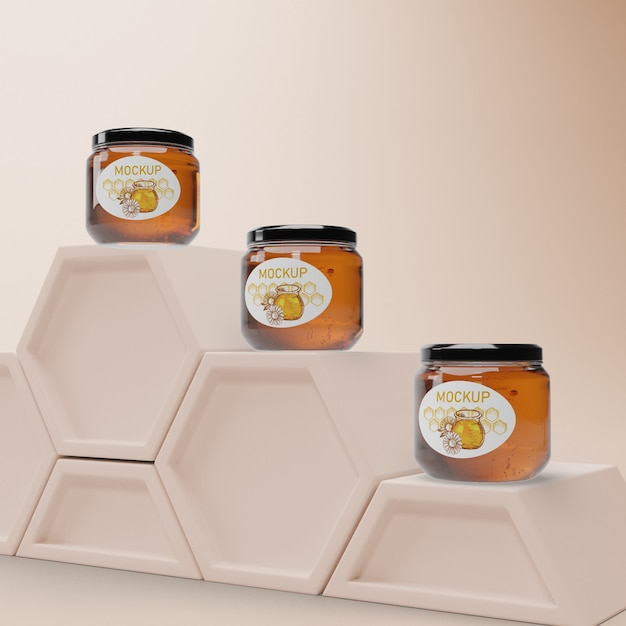 Jars with honey on honeycomb shape Free Psd
