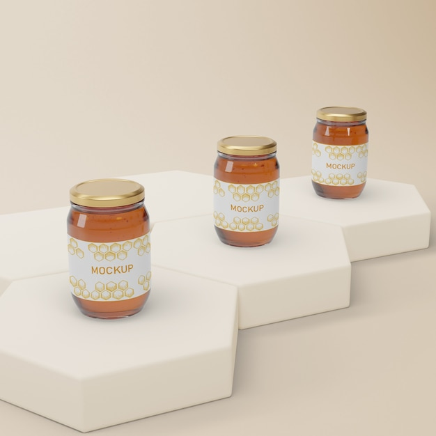 Jars with natural honey on table Free Psd