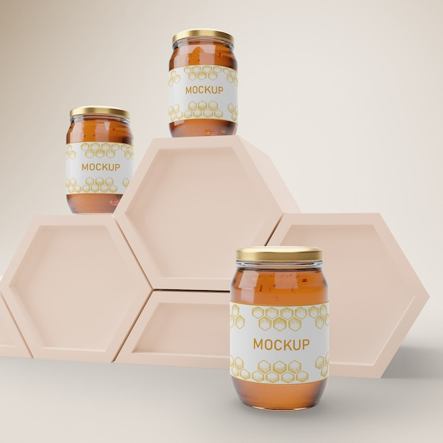 Jars with organic honey on table Free Psd