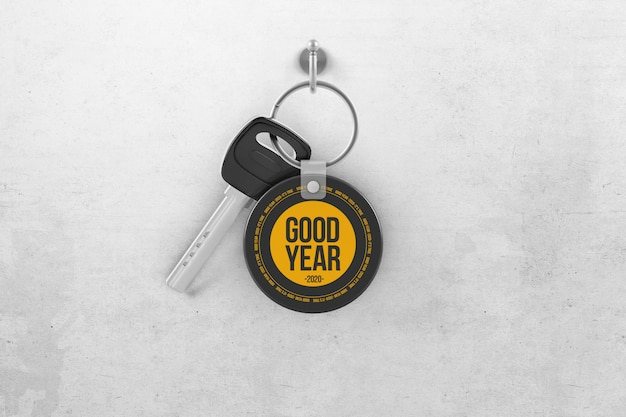 Key with circle keychain hanging on a hook mockup Premium Psd