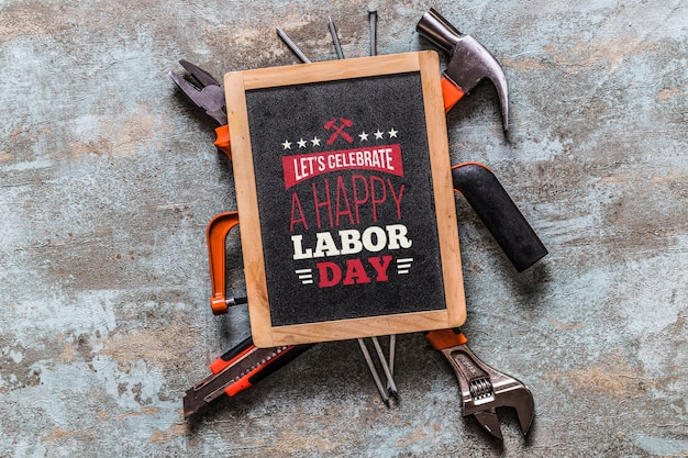 Labor day mockup with slate and tools Free Psd