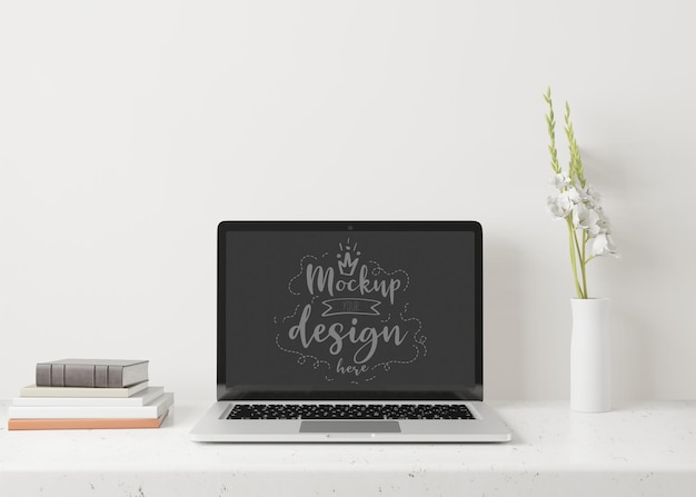 Laptop on desk in work space  mockup Free Psd