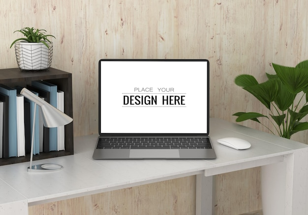 Laptop on desk in work space psd mockup Free Psd
