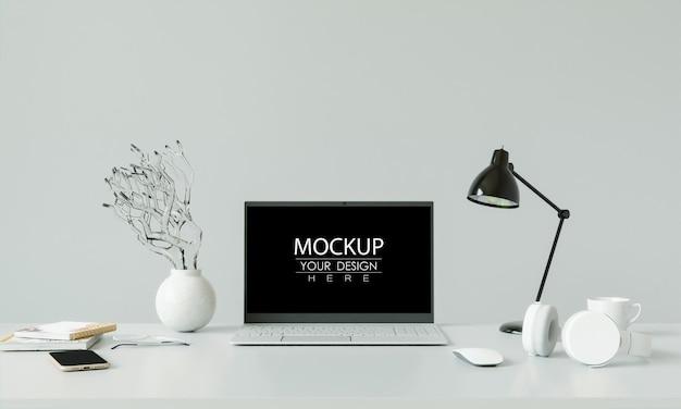 Computer portatile sulla scrivania nel mockup dell'area di lavoro Psd Gratuite