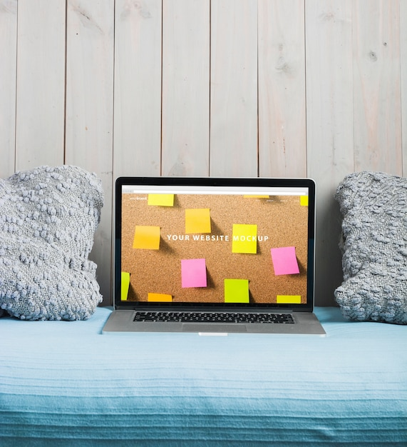 Laptop mockup on bed Free Psd