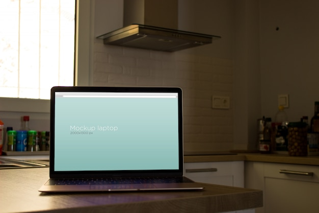 Laptop mockup in kitchen Free Psd