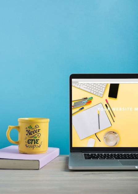 Laptop mockup and mug Free Psd
