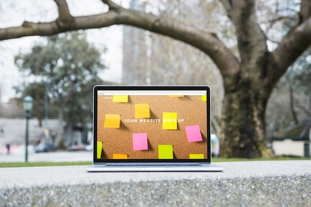 Laptop mockup outdoors Free Psd