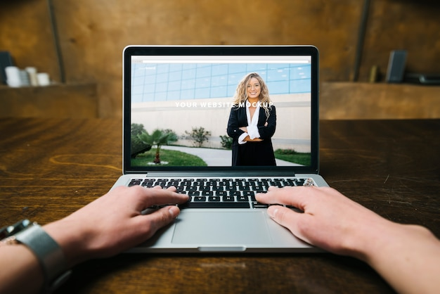 Laptop mockup with hands Free Psd