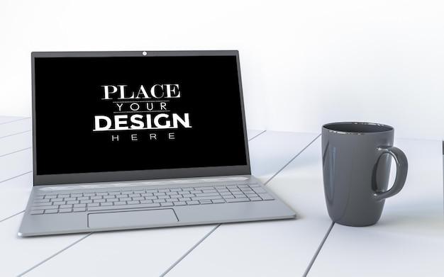 Laptop and mug on desk in workspace mockup Free Psd