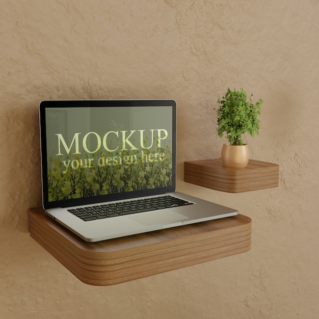 Laptop screen mockup on wooden desk with plant Premium Psd
