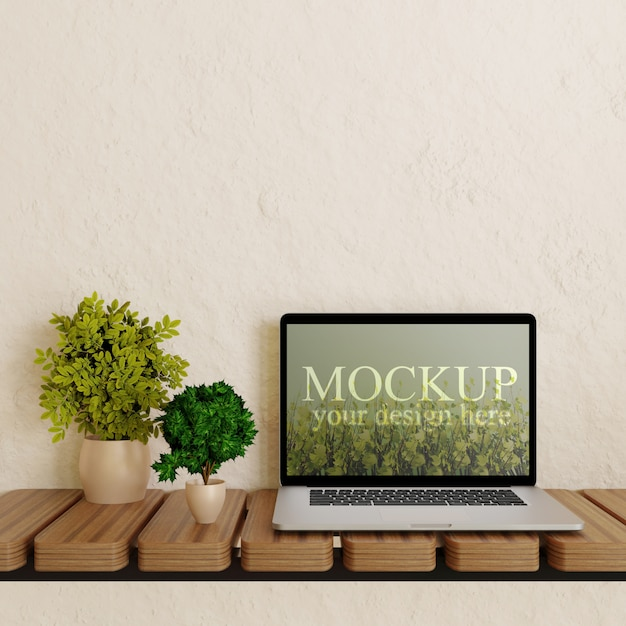 Laptop screen mockup on wooden wall desk with plants Premium Psd