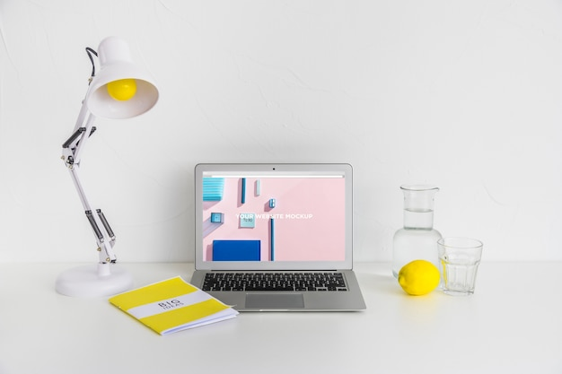 Laptop with mockup screen in clean and tidy workspace. education theme Free Psd