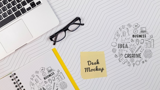 Laptop with notebook on workspace Free Psd