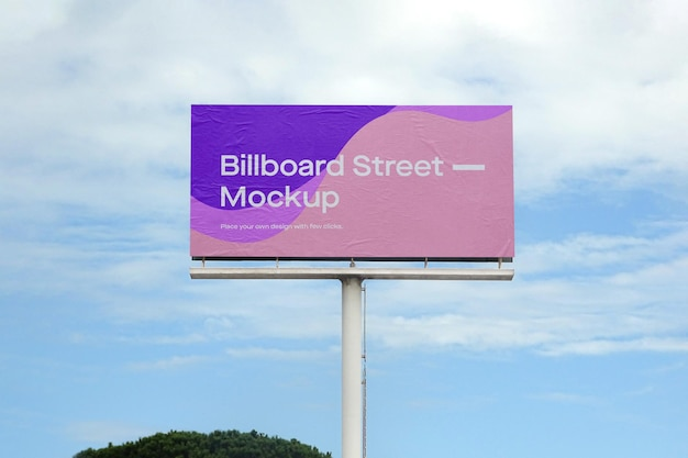 Large billboard mockup on blue sky with clouds Free Psd