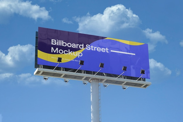 Large billboard mockup on blue sky with clouds Premium Psd